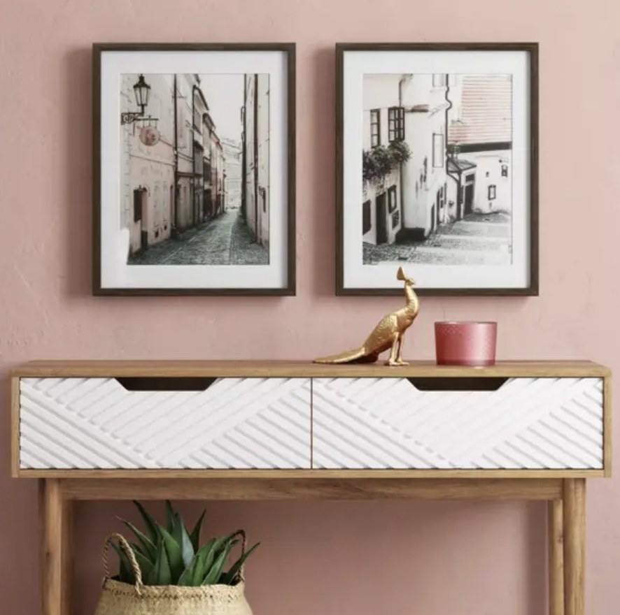 Set of photos hung over entryway table
