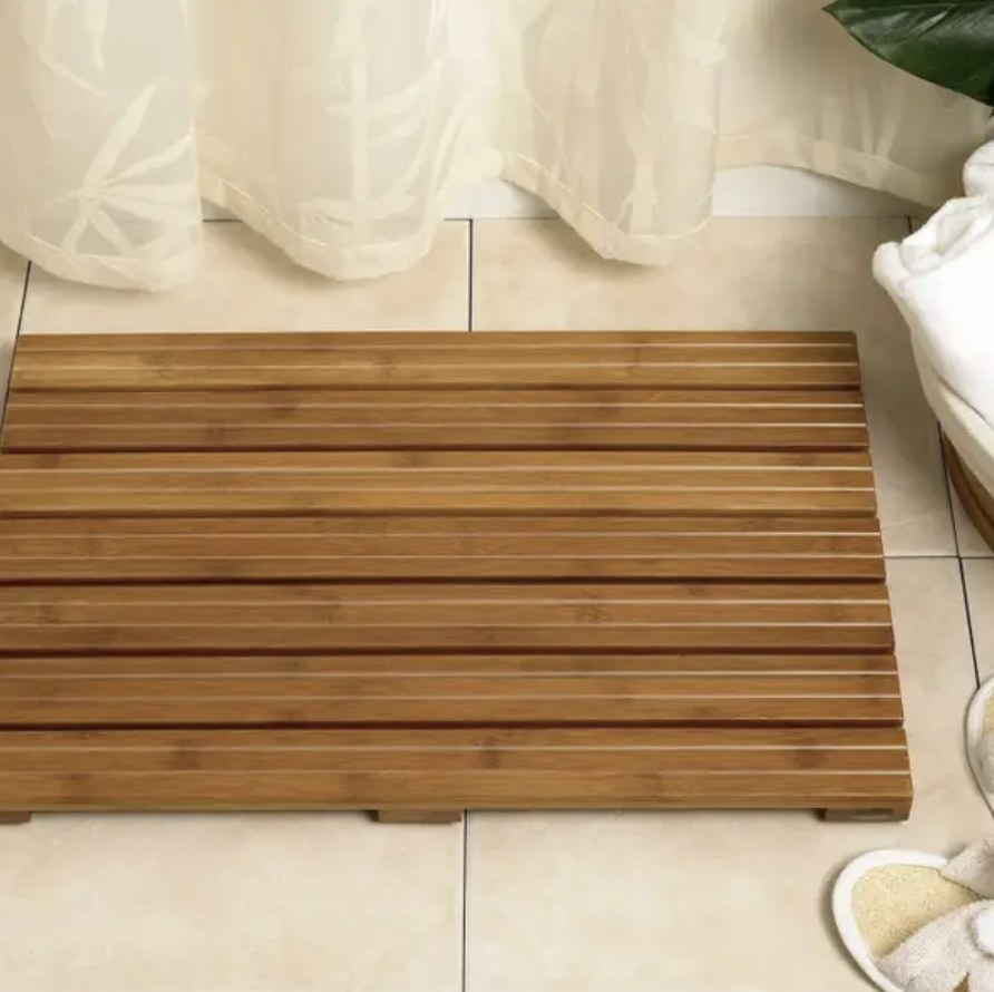 Bamboo shower mat on bathroom floor