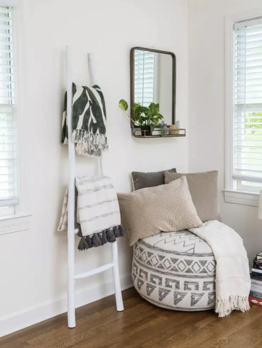 White ladder holding blankets