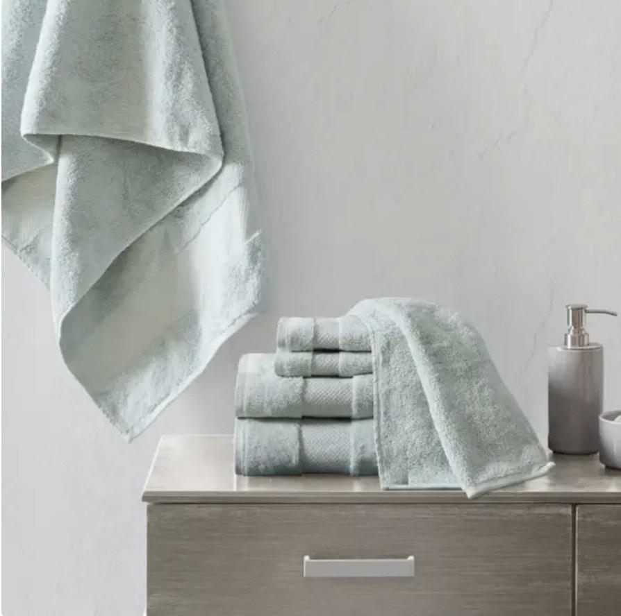 A set of bath towels on bathroom counter