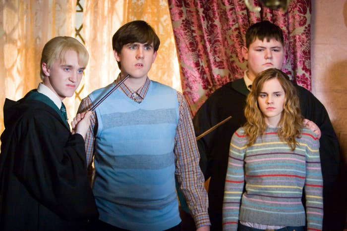 Tom Felton and Jamie Waylett hold Matthew Lewis and Emma Watson hostage in Harry Potter and the Order of the Phoenix