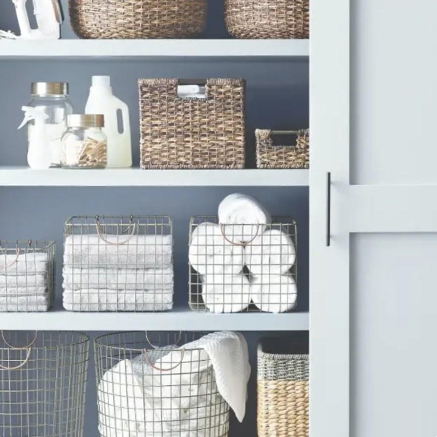 Wire baskets on bathroom shelves