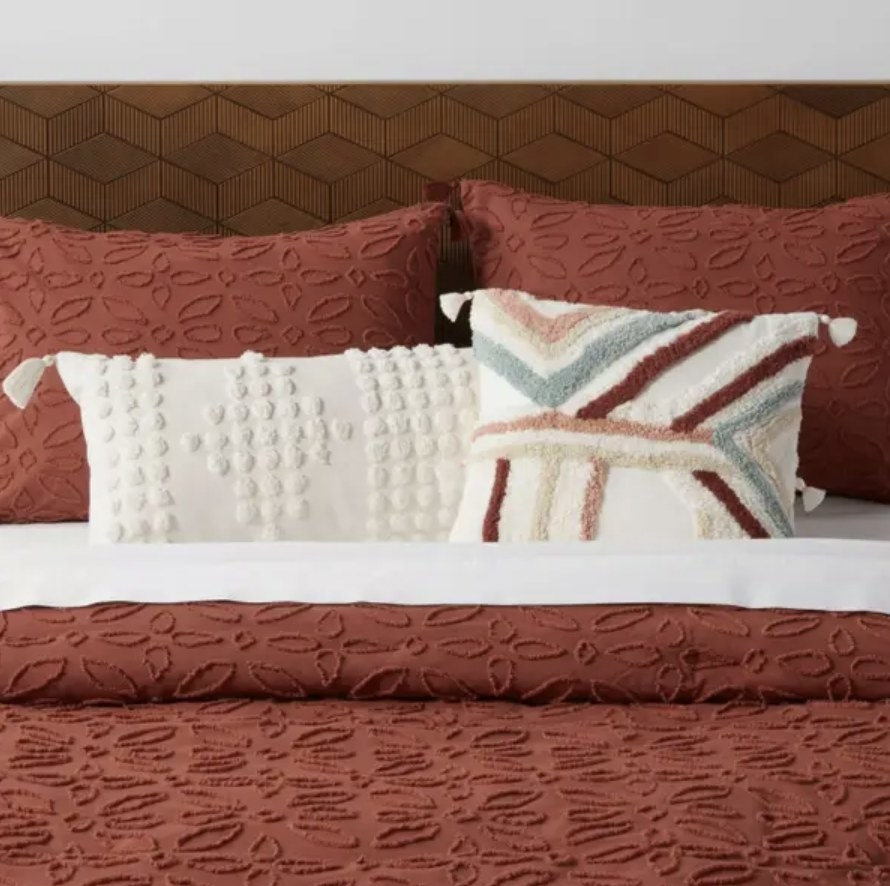 Accent pillow placed on bed