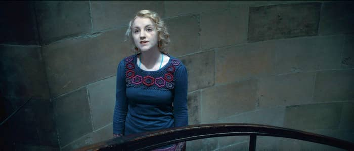 Evanna Lynch stands on a stairwell in Harry Potter and the Deathly Hollows Part Two