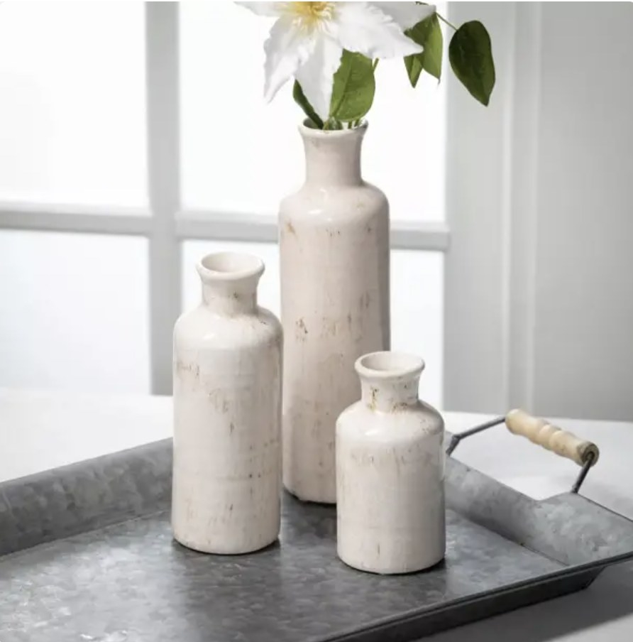 Vases displayed on metal platter