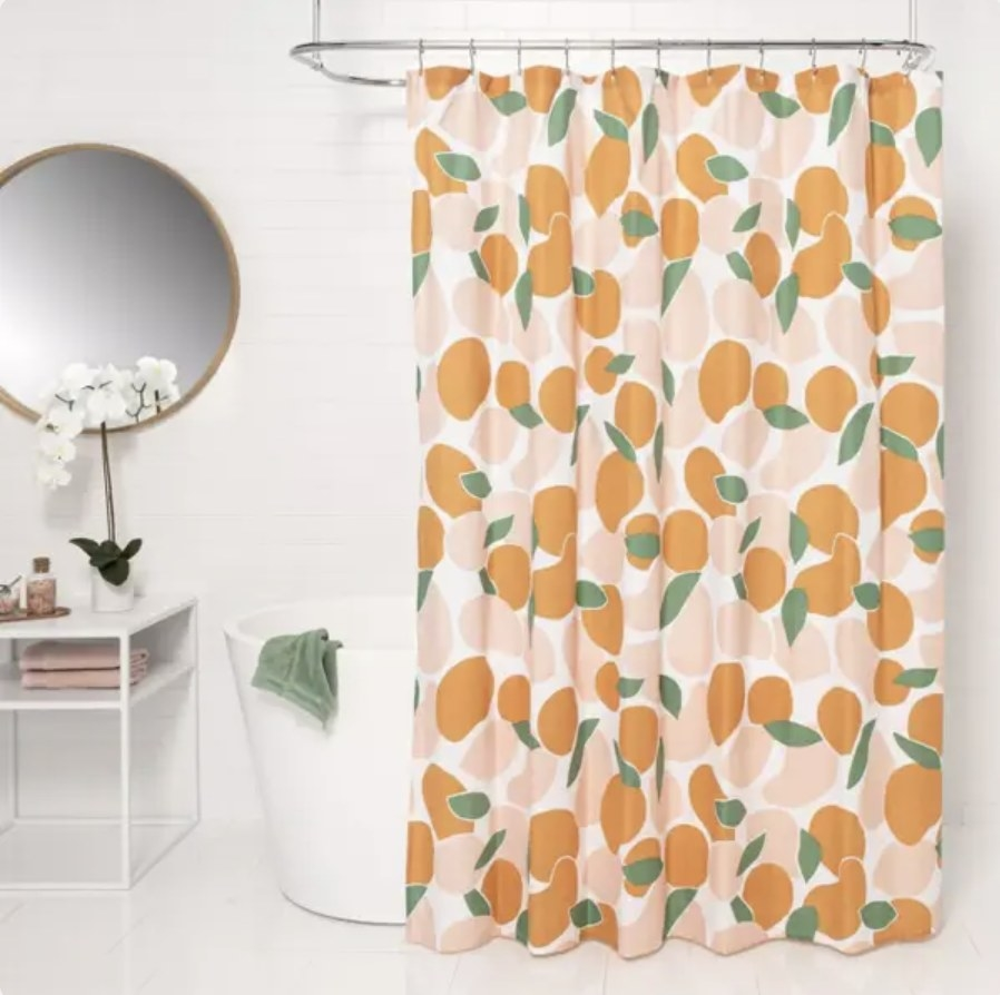 Shower curtain hanging in small bathroom