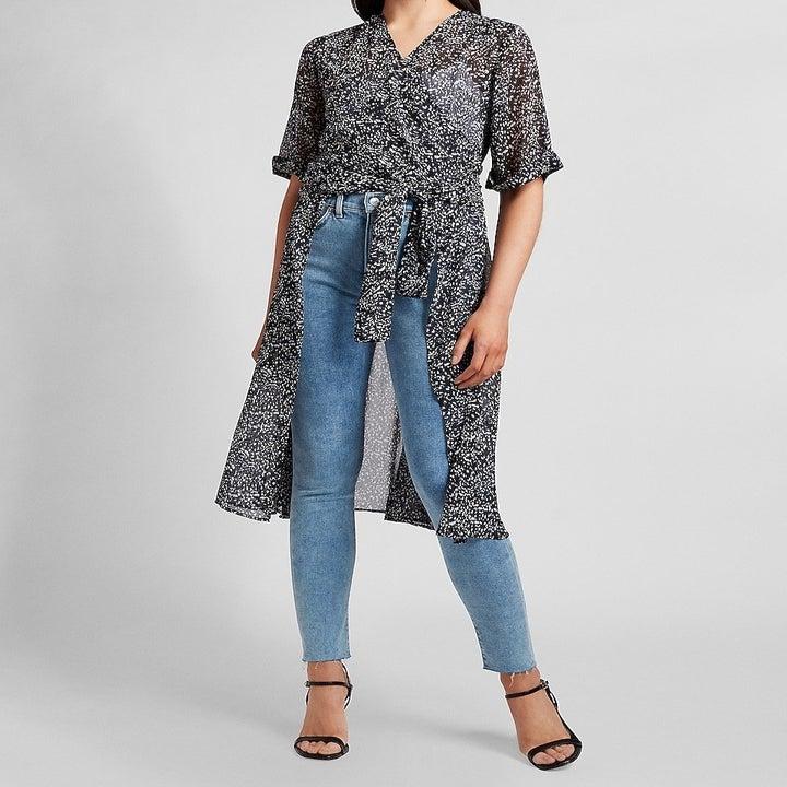 model wearing short-sleeved navy patterns wrap