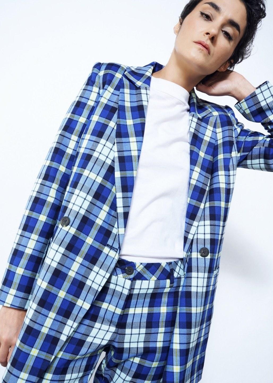 model wearing blue plaid blazer