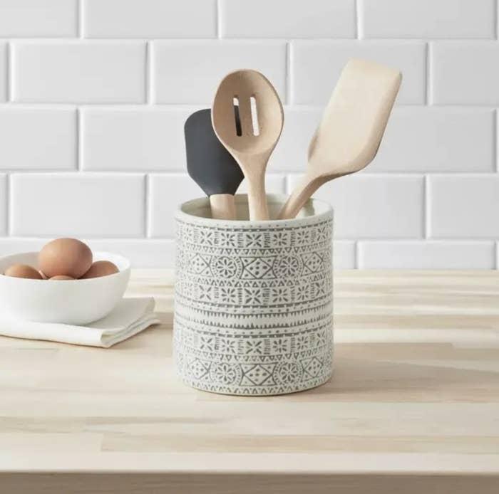 Utensil holder on kitchen counter