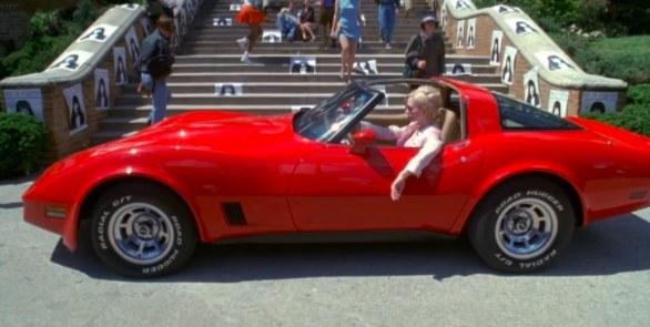 Vylette in Jawbreaker parks in front of the school in a fancy red car