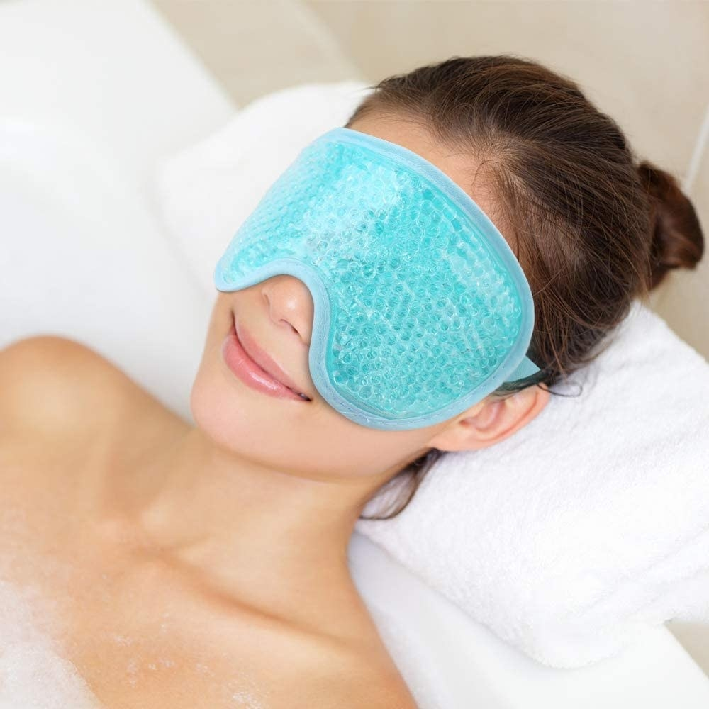 A person wearing a mask in a bubble bath
