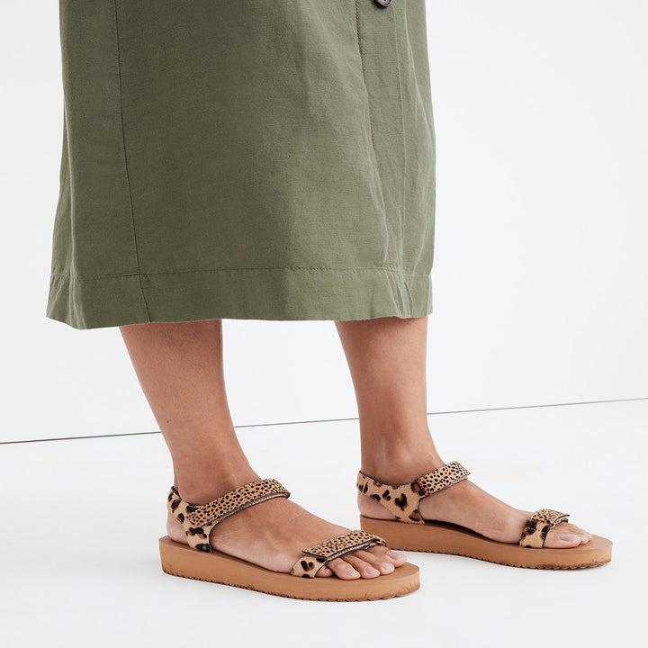 model wearing platform cheetah print sandals
