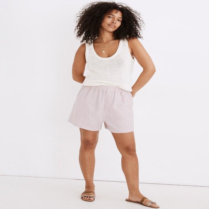 model wearing lilac elastic-waist shorts