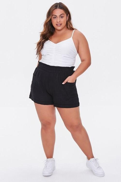 model wearing black shorts