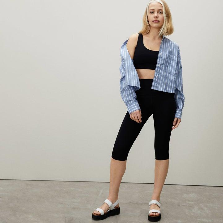 model wearing knee-length black leggings