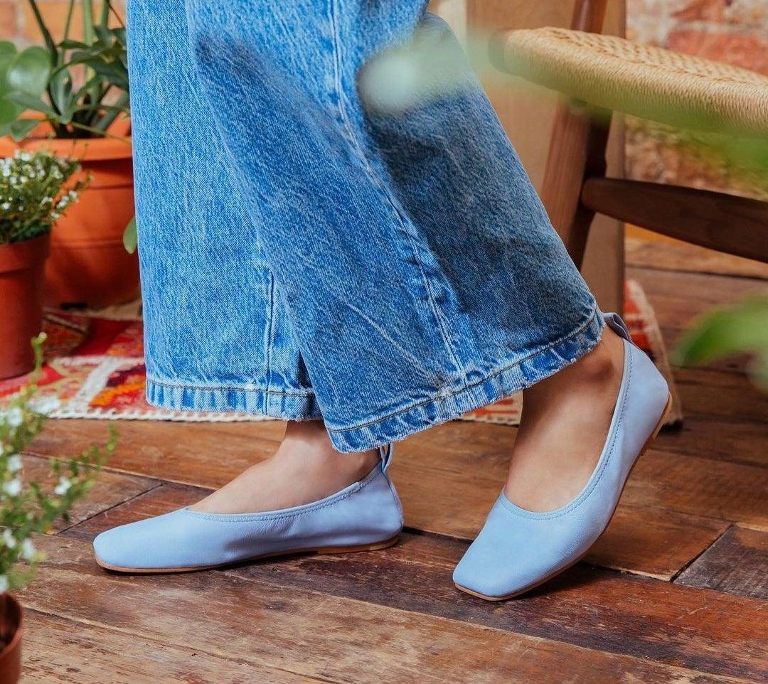 model wearing blue elastic flats