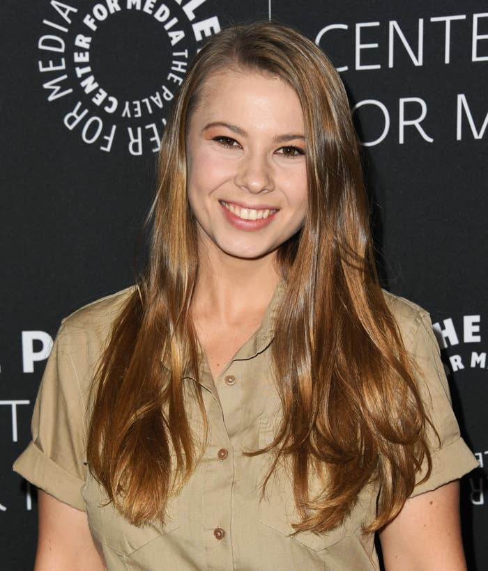 """Bindi Irwin, dressed in safari attire, smiles at the Paley Center For Media Presents: An Evening With the Irwins: """"Crikey! It's the Irwins"""" Screening and Conversation at the Paley Center for Media in 2019 in Beverly Hills"""