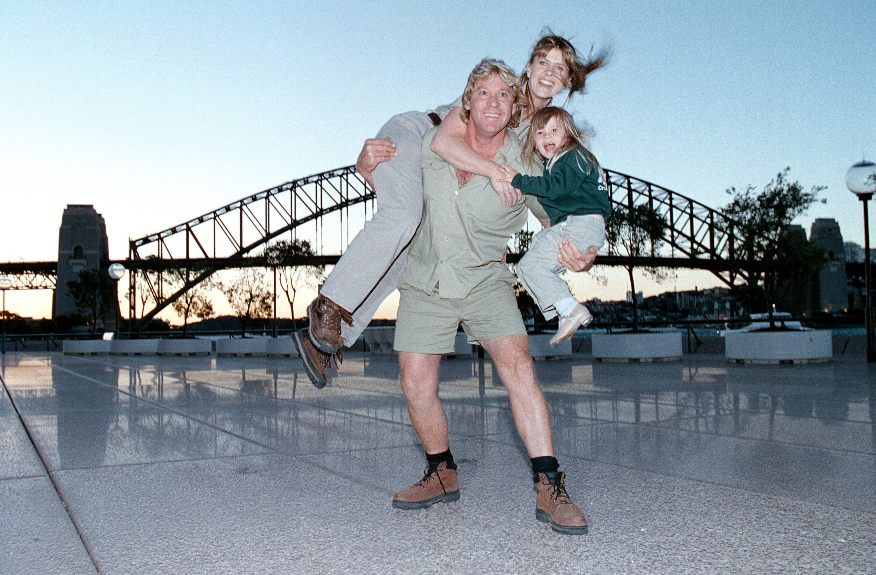 Steve lifts his wife, Terri, and daughter, Bindi, in the air at the George Street Theatre in Sydney
