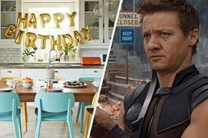An inflated happy birthday sign hangs between two cabinets and a table covered in fruit bowls and a cake. Hawkeye looks off into the distance while sharpening his arrows.