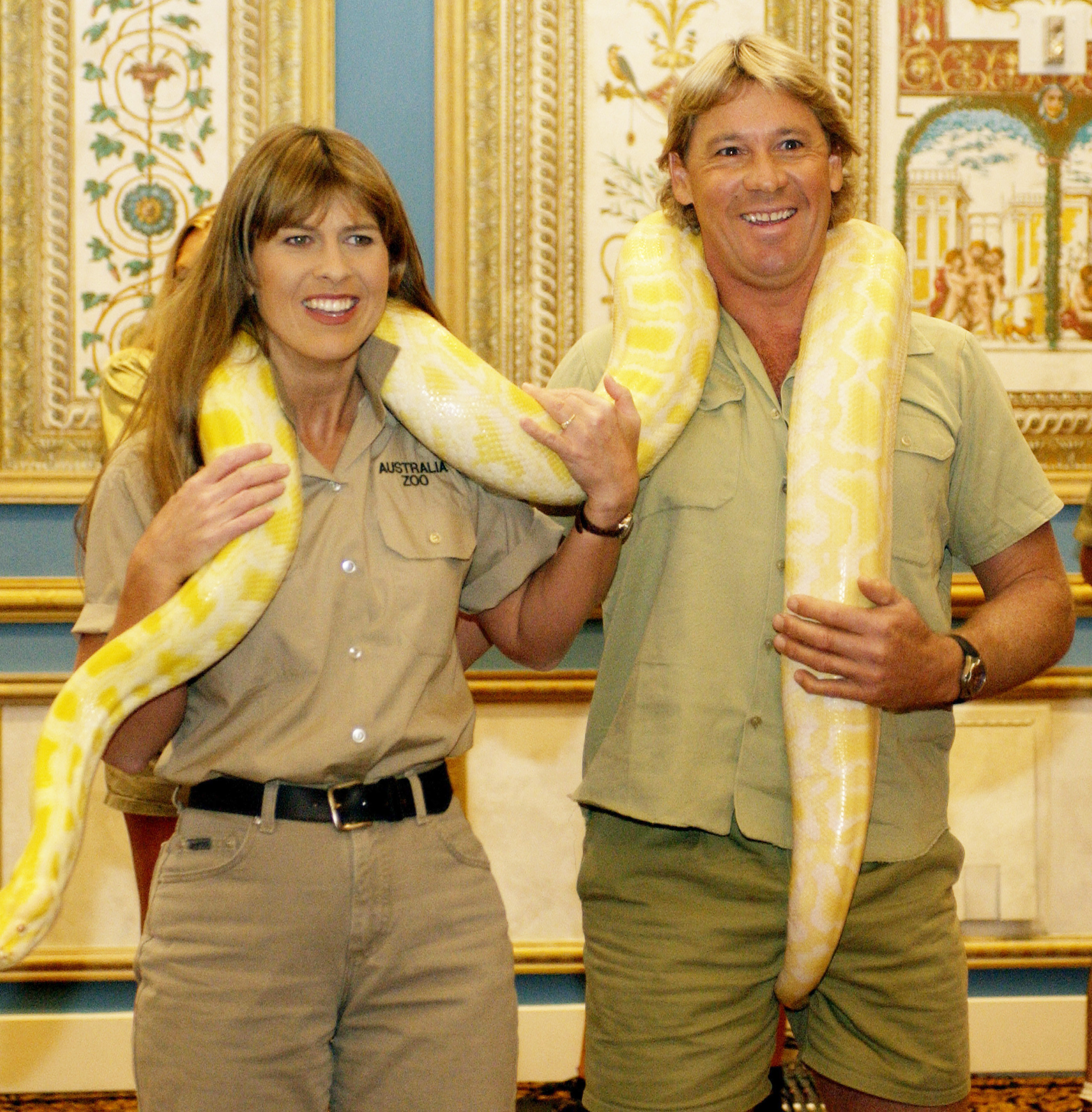 """Terri Irwin and Steve Irwin hold a giant snake and talk about their film """"Crocodile Hunter: Collision Course"""" at 2002 ShoWest in Las Vegas"""