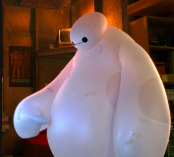 Her belly was fake like Baymax's inflated suit