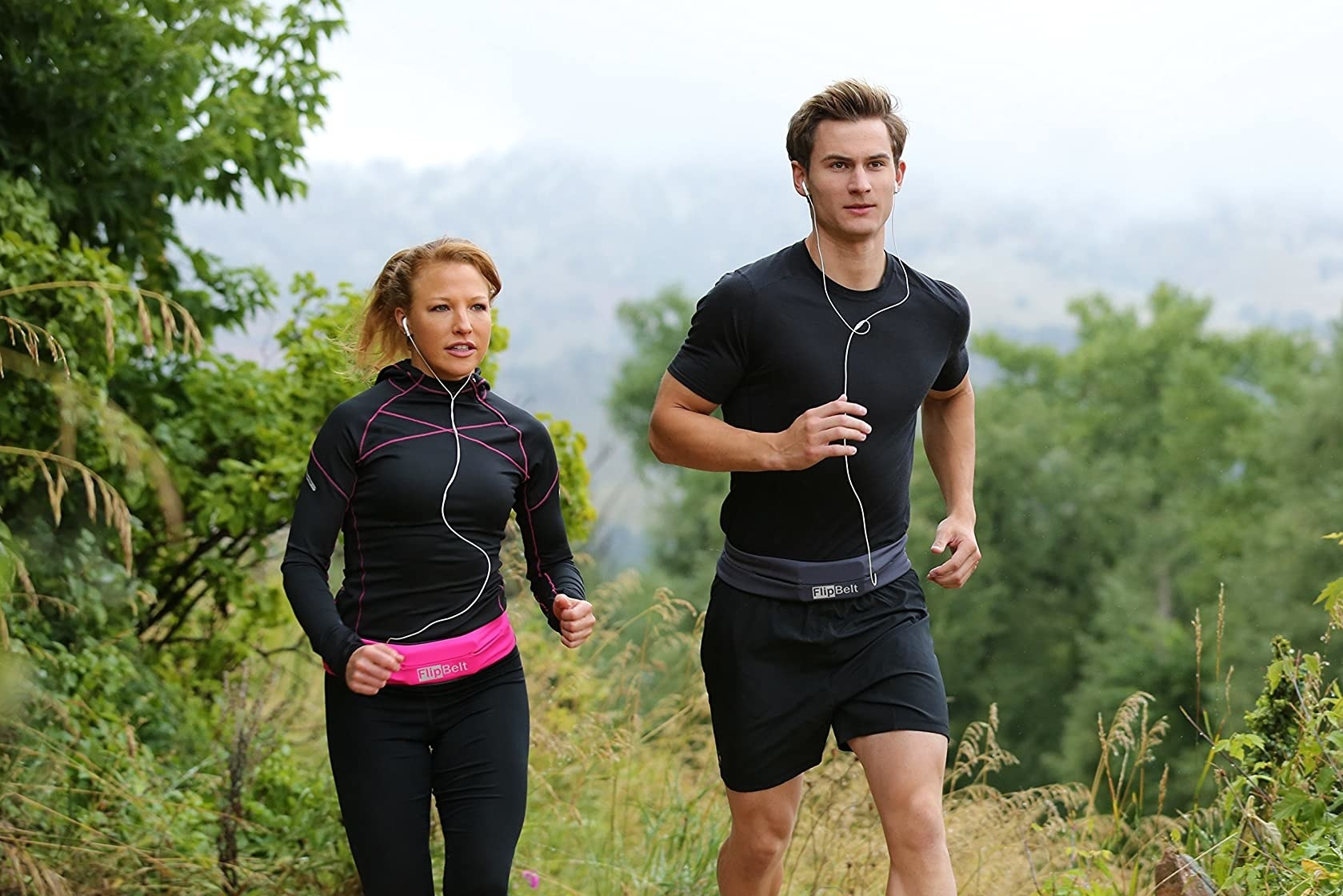 Two models wearing the waist bands to hold their phones while running