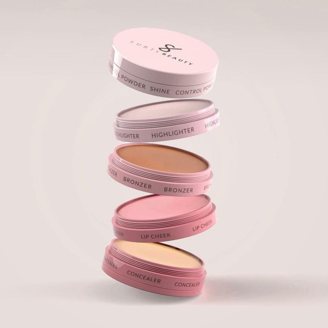 concelear, lip cheek, bronzer, highlighter, and shine control powder in a stack