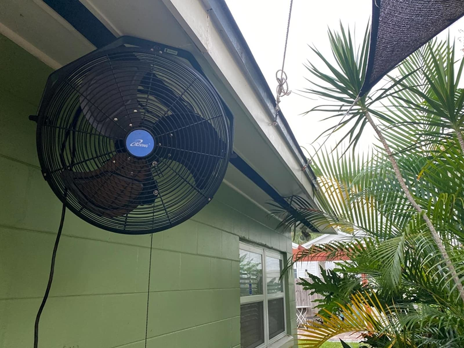 The fan hanging over a patio