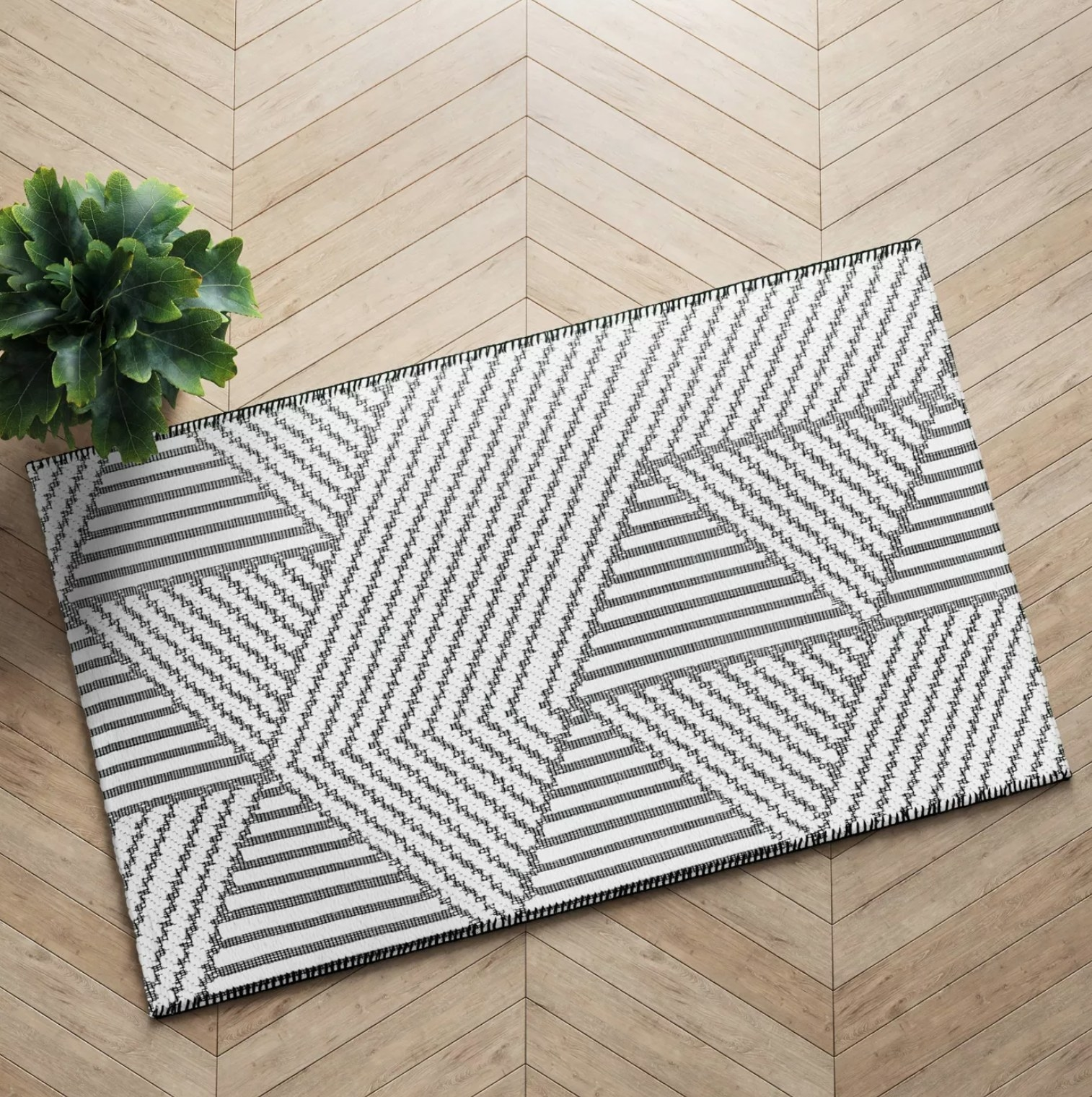 the gray and white patterned rug