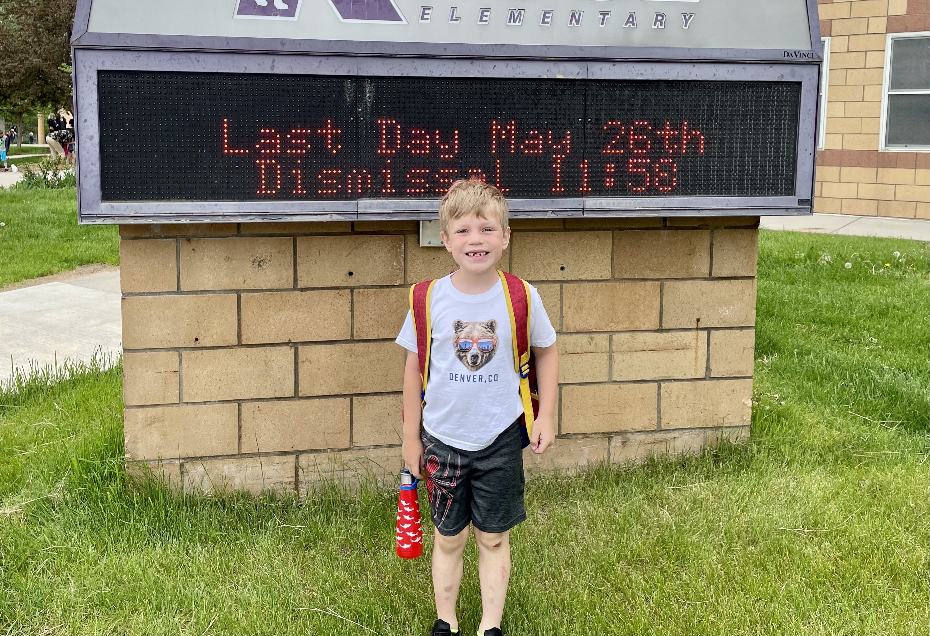 The author's oldest kid smiling on his last day of school