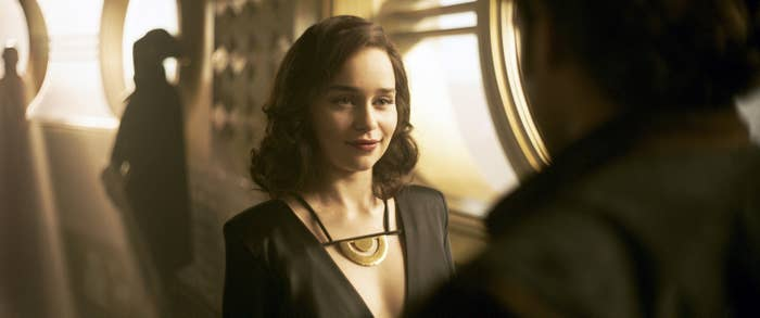 """Emilia Clarke smirks as Qi'ra in """"Solo: A Star Wars Story"""""""