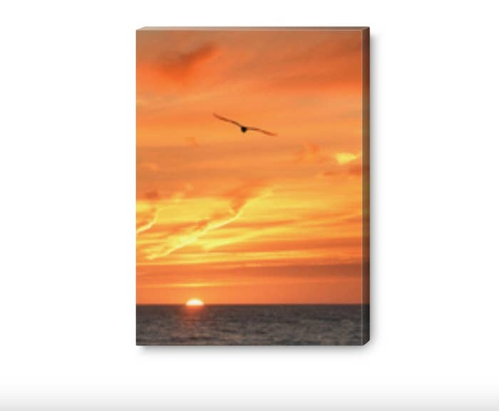 The canvas print of a sunset over an ocean