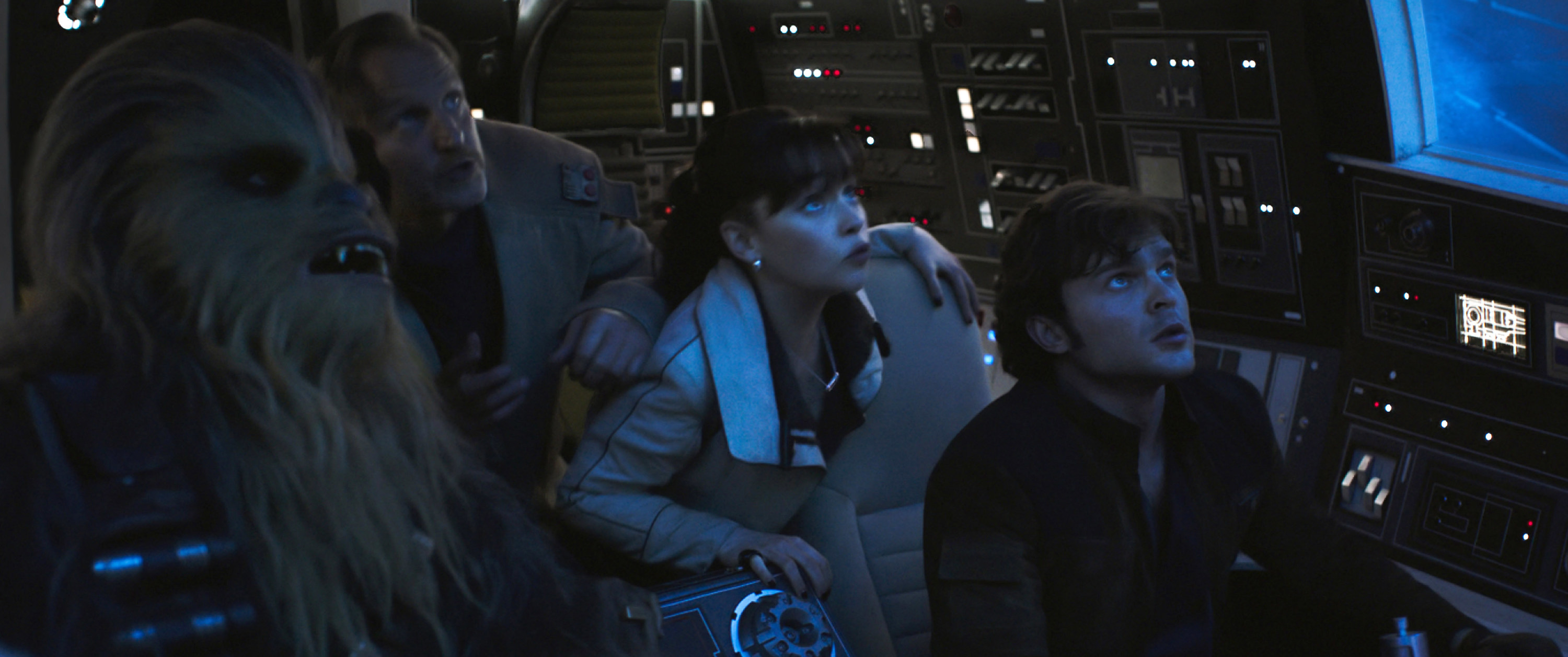 """Left to right, Joonas Suotamo as Chewbacca, Woody Harrelson as Beckett, Emilia Clarke as Qi'ra, Alden Ehrenreich as Han Solo stare off-screen in """"Solo: A Star Wars Story"""""""
