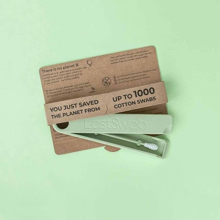 """Reusable green  swab with bumps on the tip in a green case that says """"LastSwab"""""""