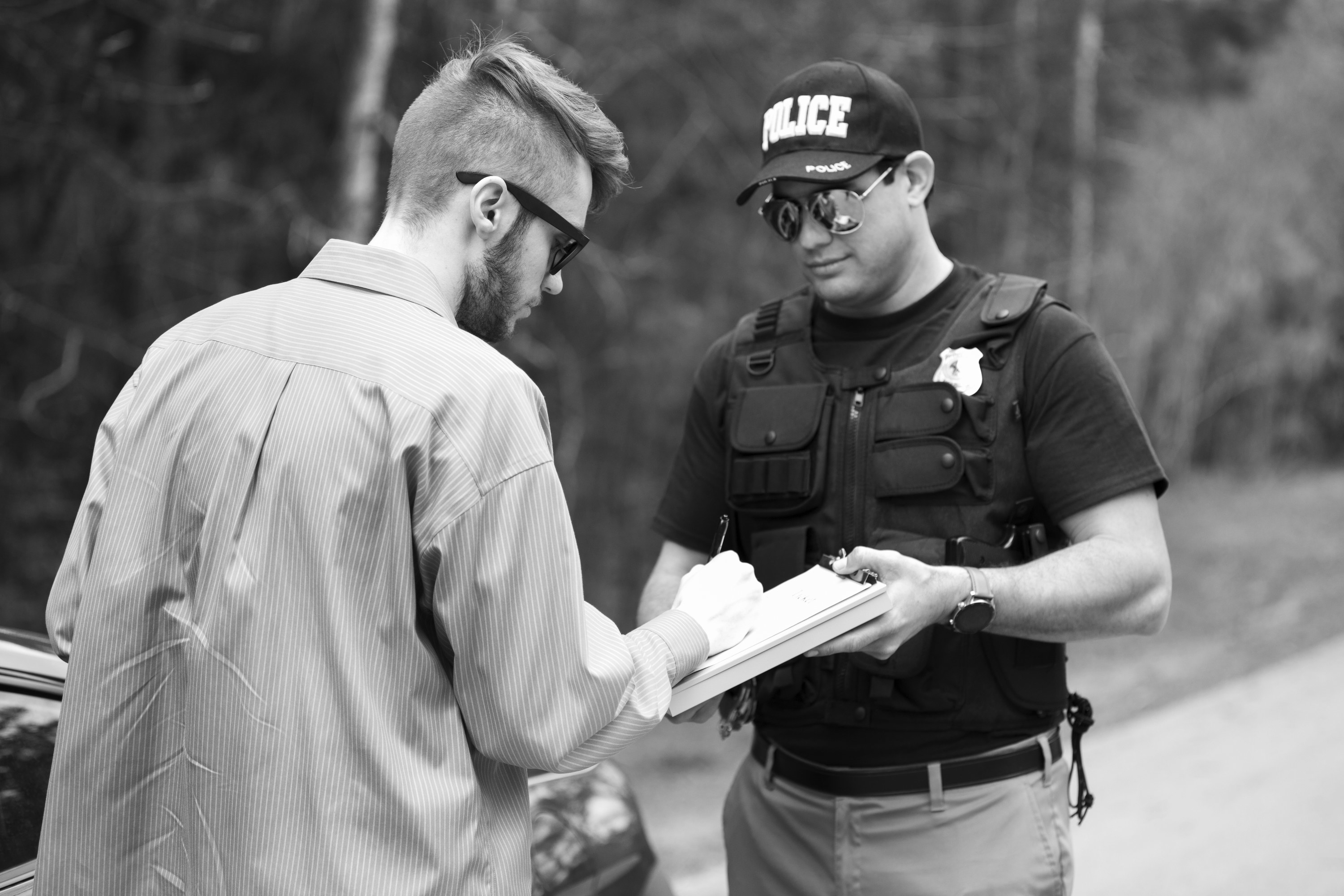 A man speaking to a police officer