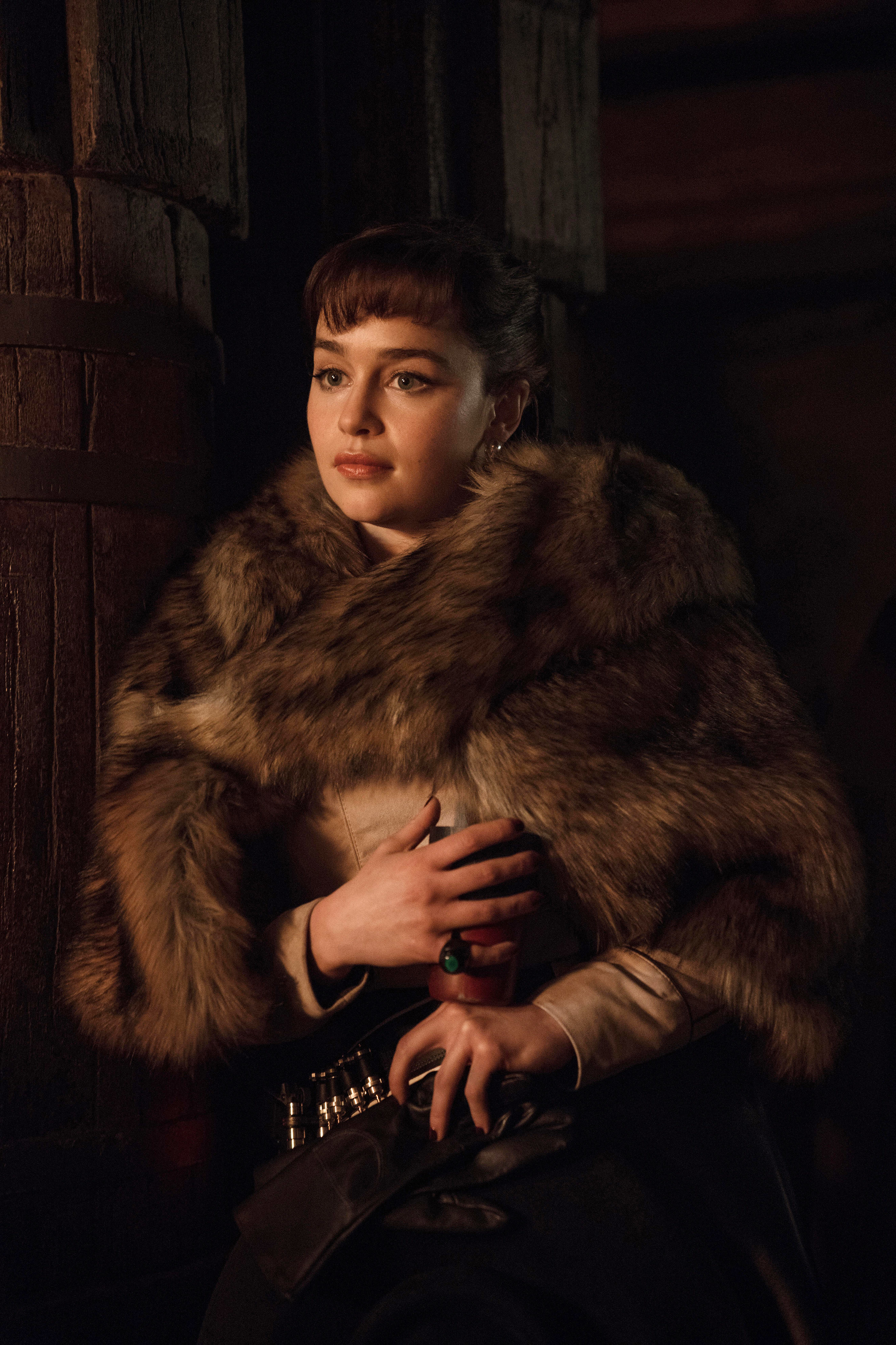 """Emilia Clarke poses in fur as Qi'ra in """"Solo: A Star Wars Story"""""""