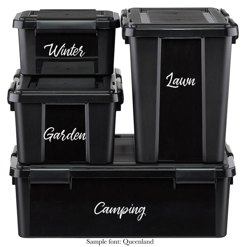 The bins with text on them in Queenland font