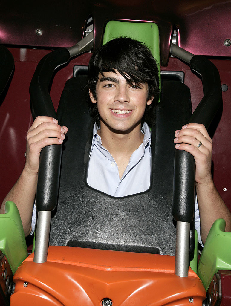 riding a rollercoaster with long bangs