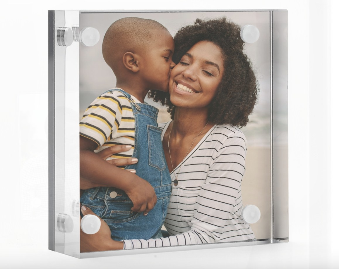 The fridge magnet holding a picture of a mother and son