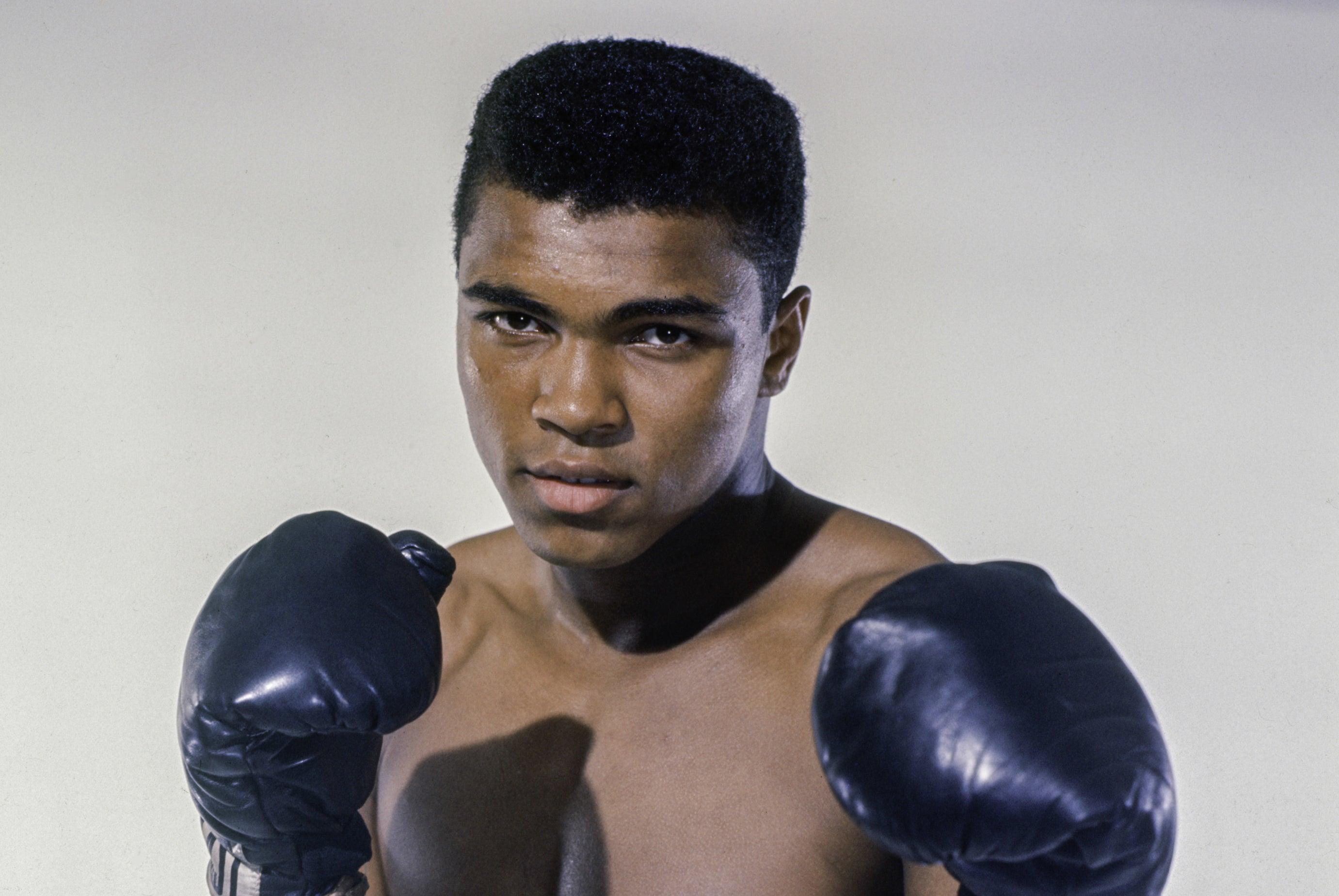 Photo of Muhammad Ali wearing boxing gloves