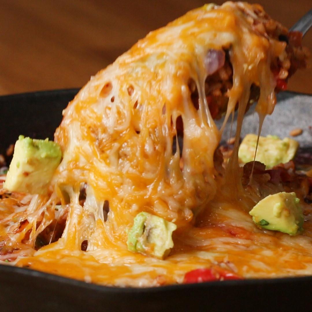 Cheesy enchiladas with avocado