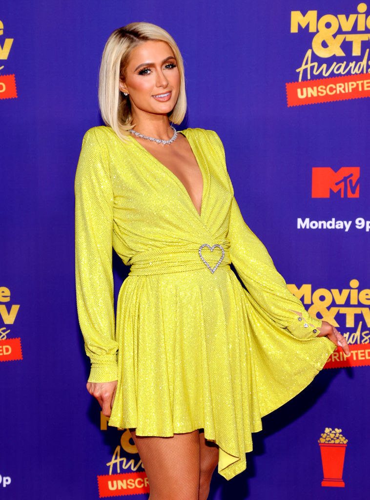 in a bright yellow dress