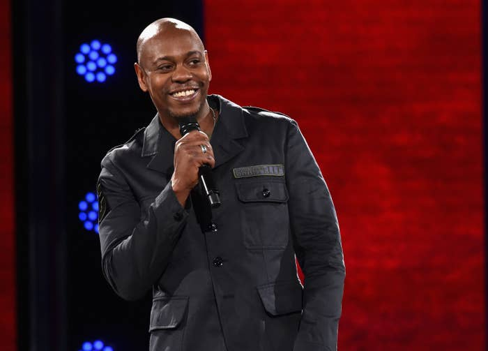 Photo of Dave Chappelle performing