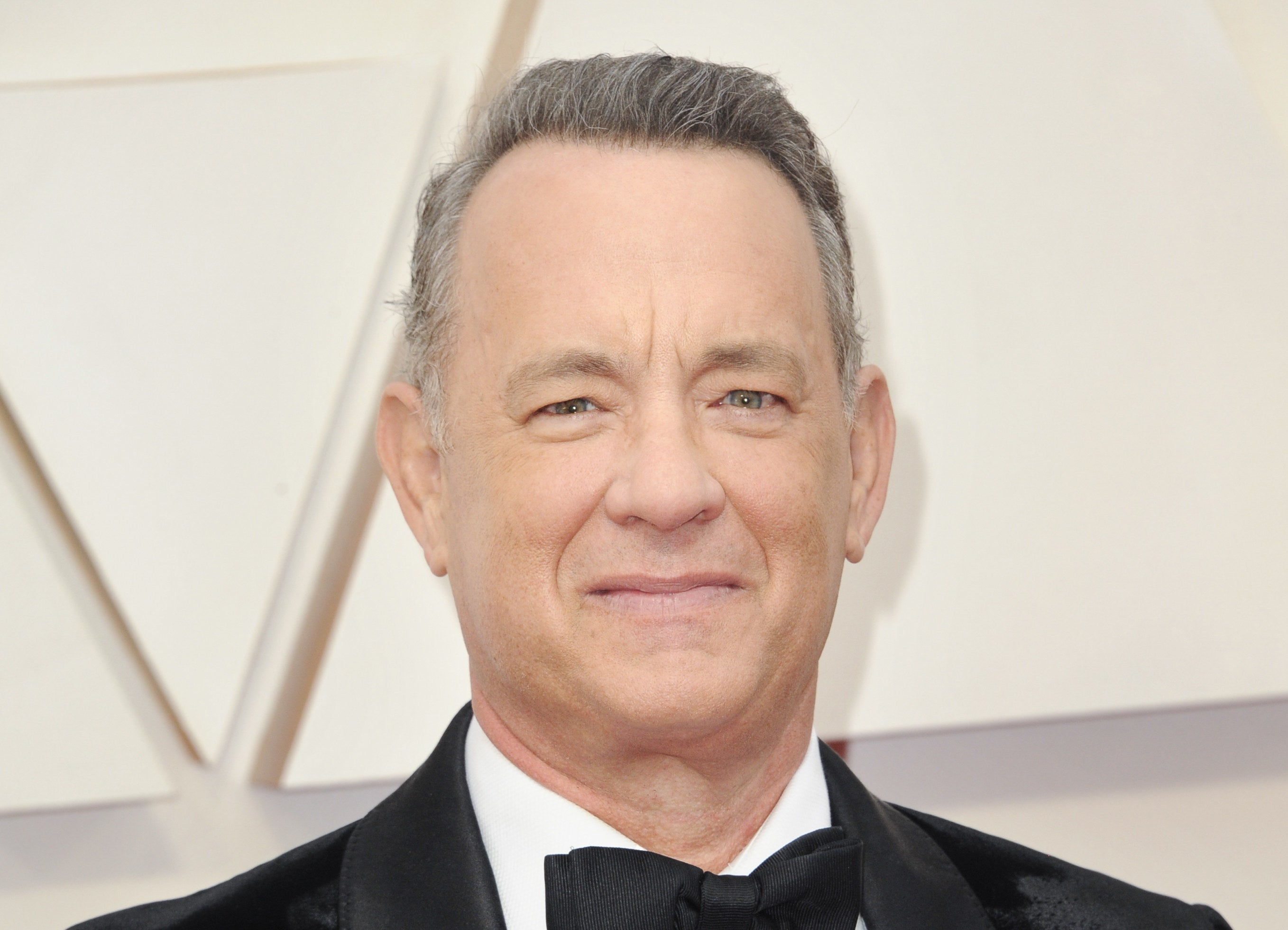 Photo of Tom Hanks in a suit at an awards show