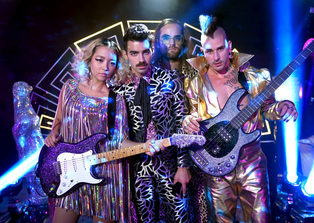 Joo Lee, Joe Jonas, Jack Lawless and Cole Whittle of DNCE perform during a pre-taping for the 2017 MTV Video Music Awards at the Palms Casino Resort