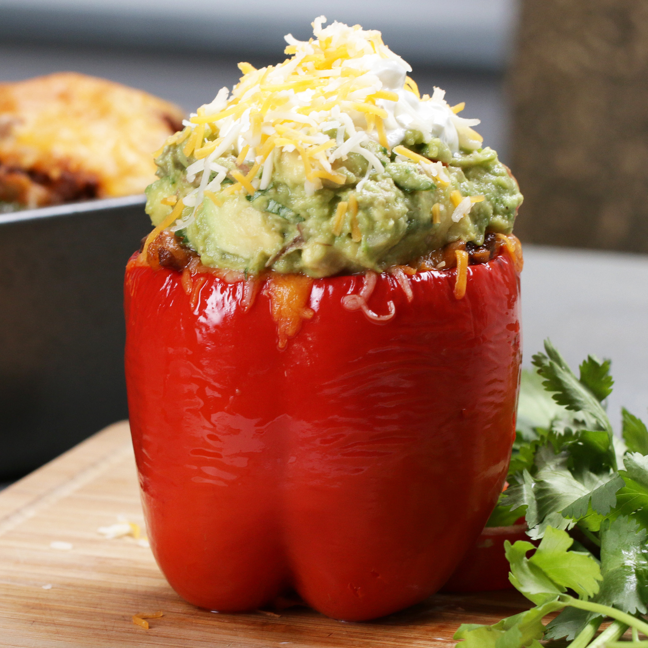Stuffed red pepper topped with guacamole