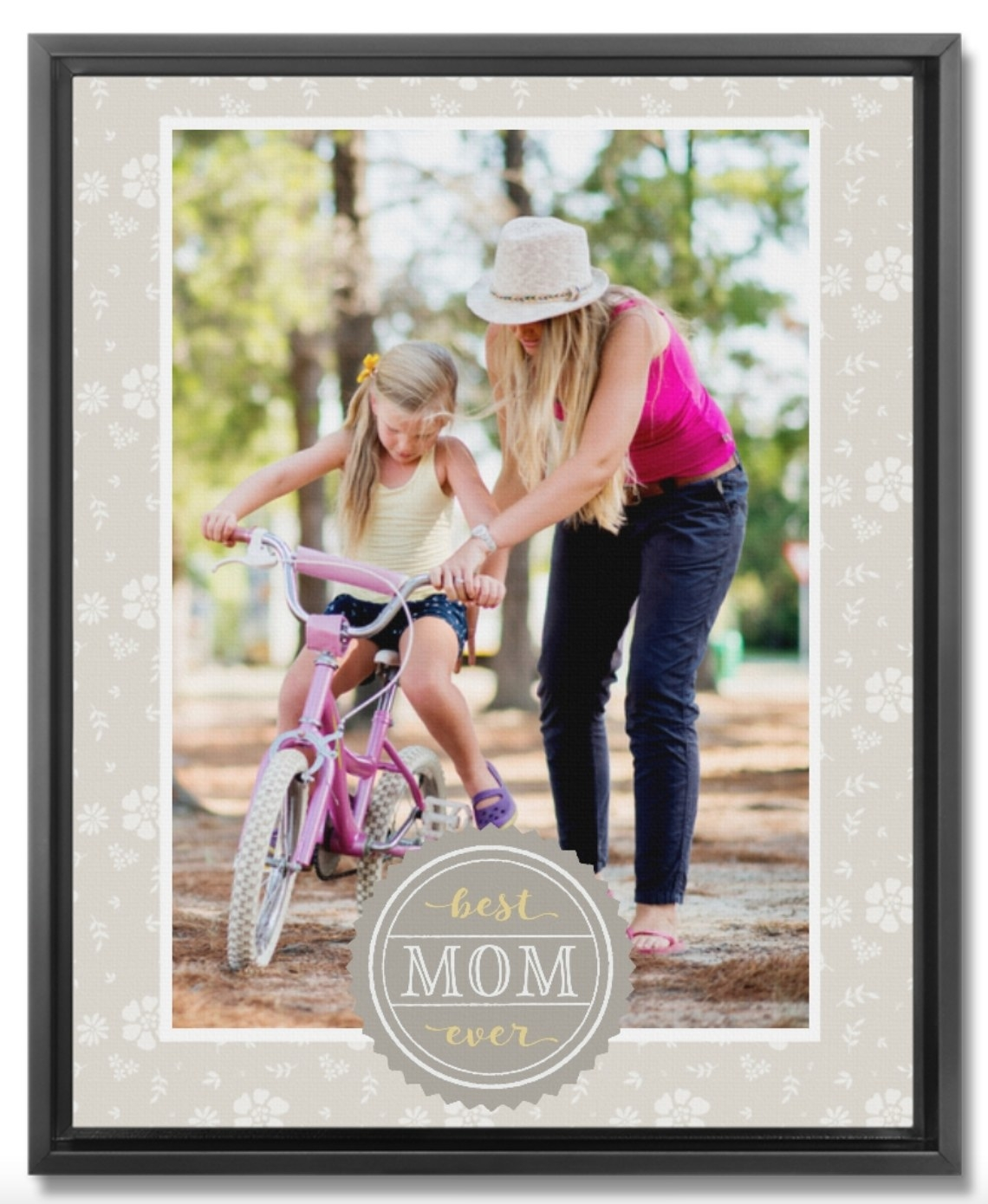 a framed canvas print of a mother and daughter