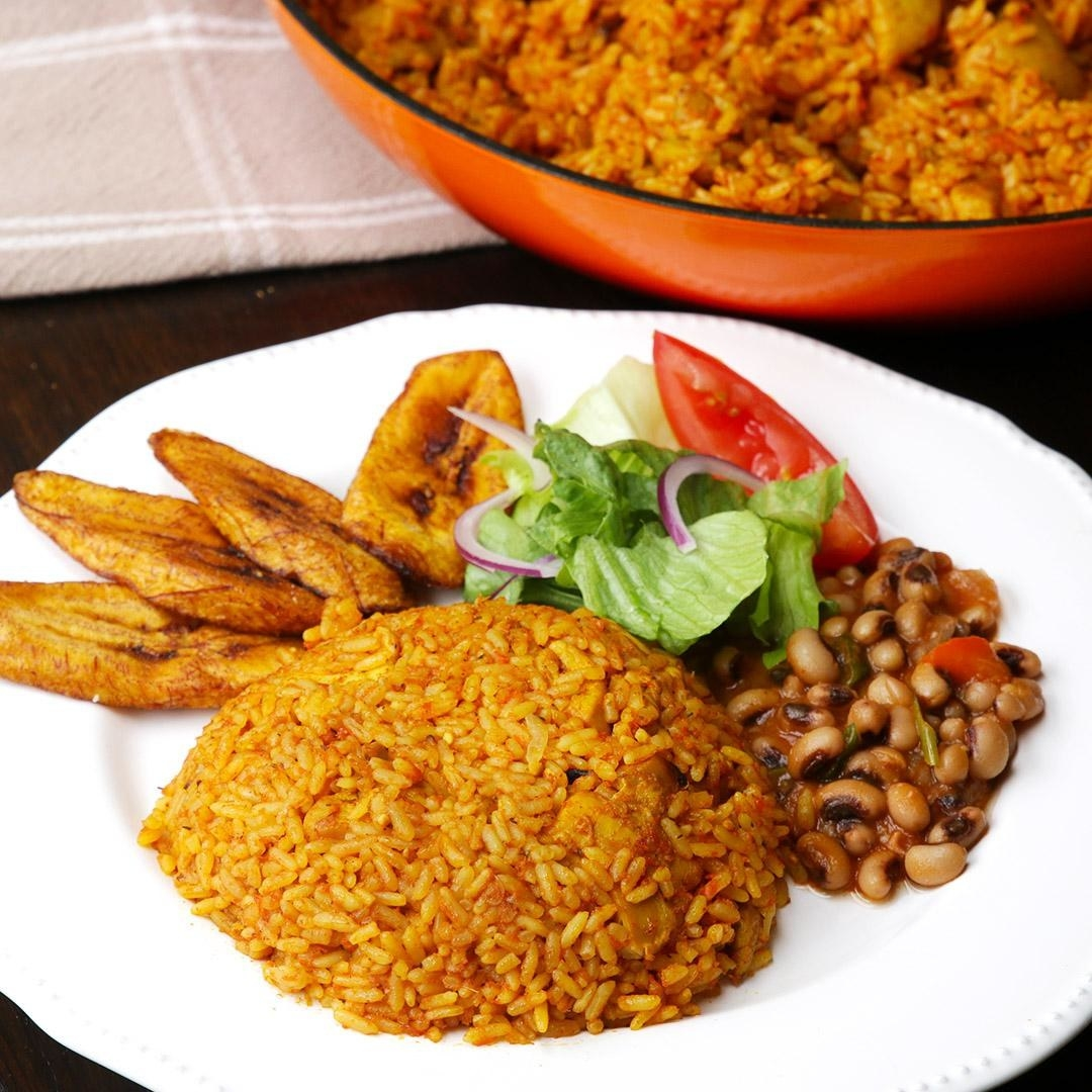 Plate of rice, beans, salad, and plantains
