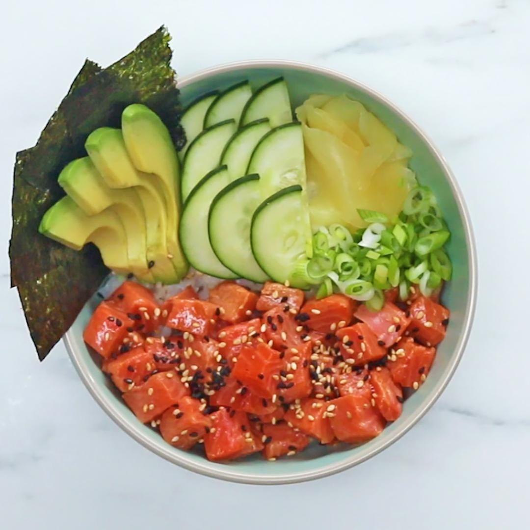 Bowl of raw salmon and veggies over rice