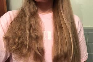 reviewer with thick, wavy hair showing one side of their side wavy and a little frizzy and the other side straight and smooth